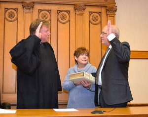Commissioner Don Douglas sworn in by Judge Bruce Winters